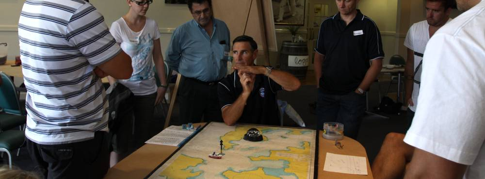 National Maritime College image boat licence students learning how to read a nautical chart